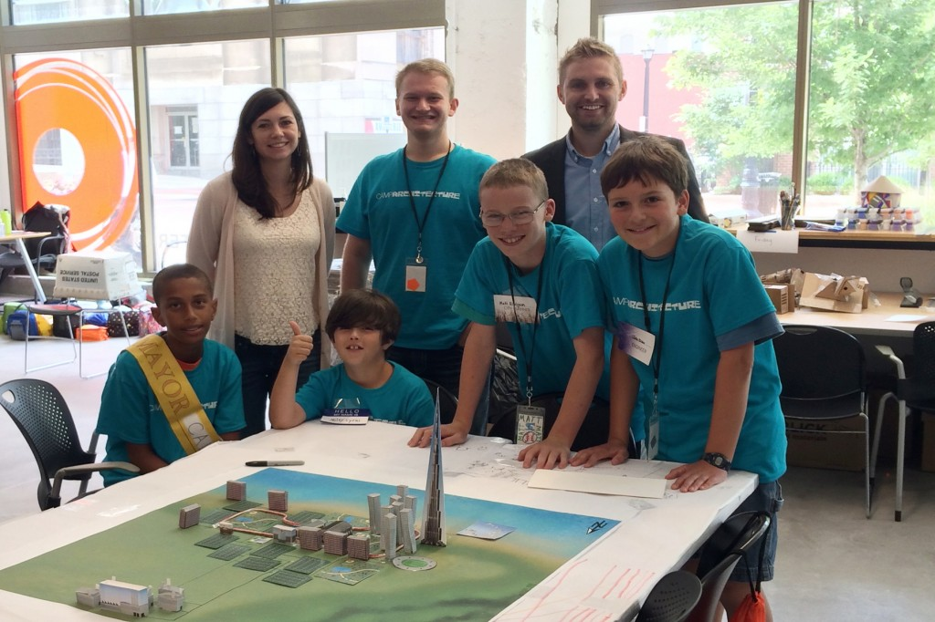 Sarah and Kyle with Camp Architecture children
