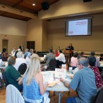 A large group gathers to discuss the future of North Olmsted